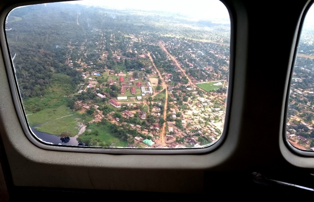 Photo of a city from above, looking out of an airplane window